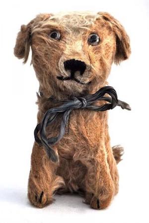 A Rare Omega Dog Cigarette Canister, 1920s